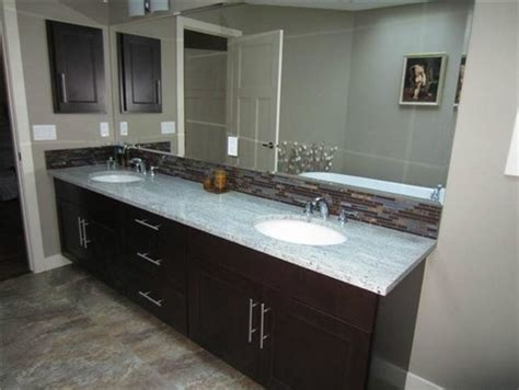 Types Bathroom Countertop Materials by Tile To Go With Kashmir White Granite And Dark Cabinets