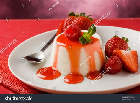 photo of italian panna cotta dessert with strawberry sirup and mint leaf 74889625