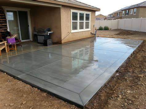 broom finish concrete patio slab with 12 border bands