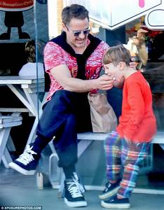 Robert Downey Jr plays doting dad as he feeds his son ice ...