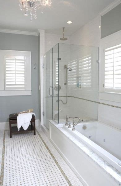 bathroom with blue gray walls paint color marble basketweave inset tiles frameless glass
