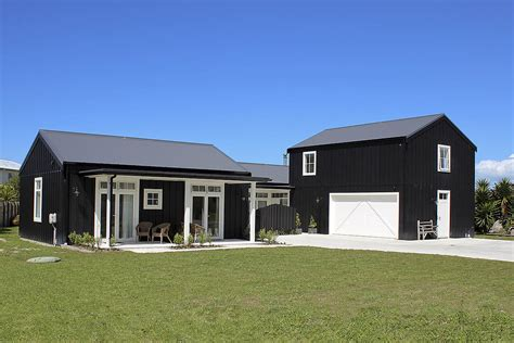 architecturally designed barn inspired ply batten home