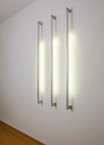 linear wall mounted fluorescent luminaire for m c2