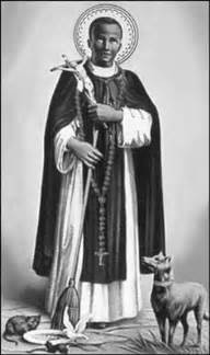 Statues of St. Martin de Porres show him holding a broom, with a dog, cat and mouse at his feet