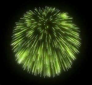 Green festive fireworks explosions over black background ...
