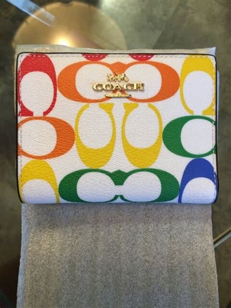 For more information or to adjust cookie settings, please click here. Coach Rainbow Pride Chalk Multi Signature Snap Card Case Wallet 3307 for sale online   eBay