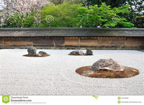 zen garden raked the stones of the ryoanji temple garden