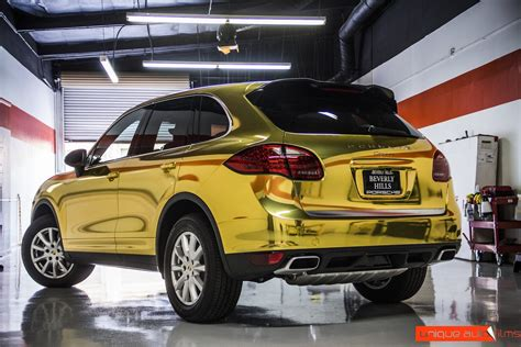 chrome wrapped cars project 24k gold porsche cayenne gold chrome vinyl wrap