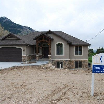 Cf Olsen Homes, Exterior, Stucco And Rock, Wood Arch
