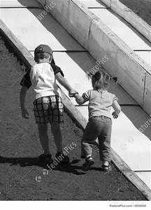 Street Life: Boy Helping Girl Up Hill - Stock Image ...