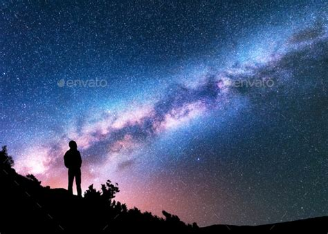 Silhouette Man Against Night Sky With Milky Way Stock