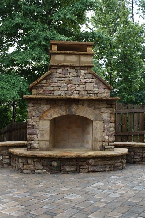 stacked stone outdoor fireplace with hearth and seating