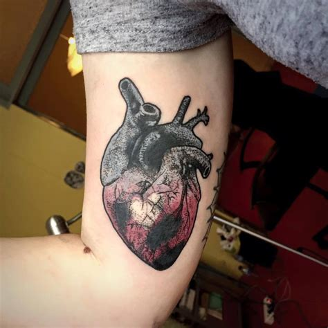 black ink real heart tattoo  man  side rib