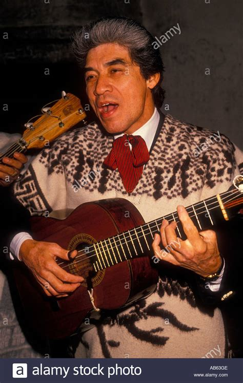 mexican american man playing guitar guitar