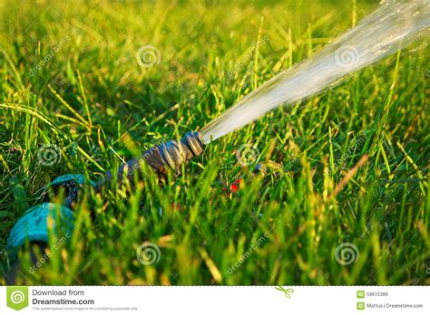 Garden Watering. Flow Of Water Pouring Out Of Pipe Stock