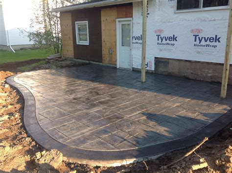 Backyard Cement Ideas by Rochester By Sted Concrete Patio With A Stained Border
