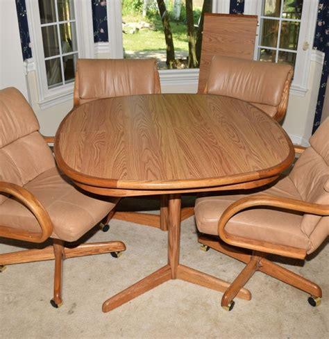 oak kitchen table   leather  oak swivel chairs