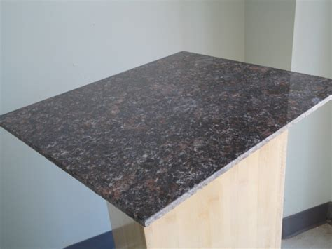 lazy granite brown countertop tile traditional
