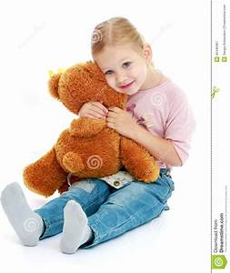Little Girl Hugging A Teddy Bear. Stock Image - Image ...