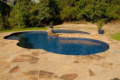 trilogy fiberglass pool  stone deck  tanning ledge