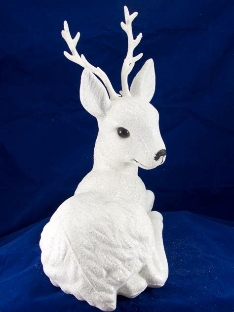 white sitting glittered reindeer ornament cm