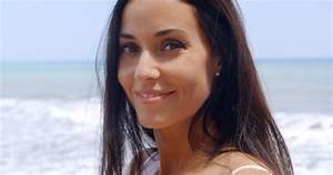 Pretty Woman At Beach With Happy Facial Expression By