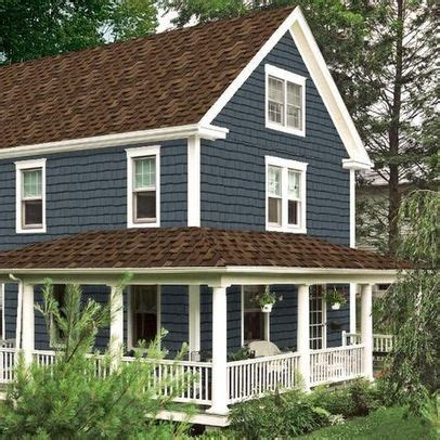 brown roof blue siding white trim house remodel in