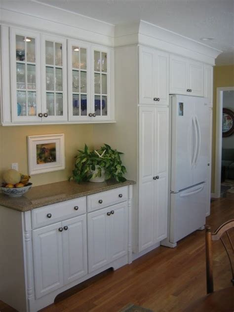 cabinets around fridge 25 best ideas about refrigerator cabinet on
