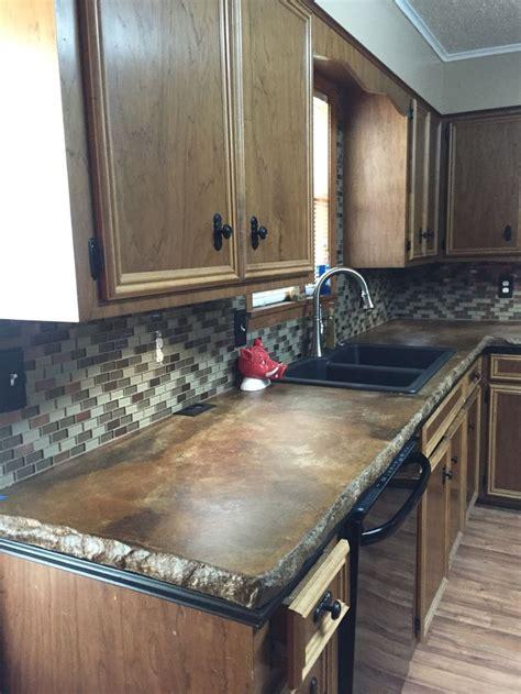 kitchen renovation concrete countertops glass tile