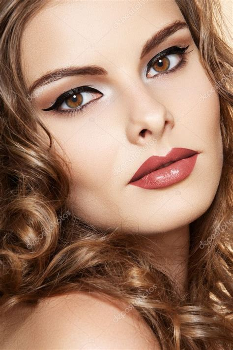 Beautiful face of young woman with clean skin, bright ...