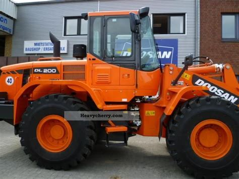 doosan dl   wheeled loader construction equipment photo  specs