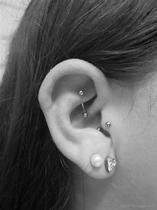 Heart Lobe Tragus And Rook Piercing