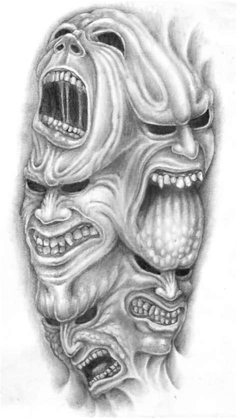 Tribal And Flaming Demon Skull Tattoos Designs