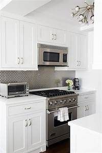kitchen with gray mini brick tile backsplash With kitchen colors with white cabinets with phases of the moon wall art