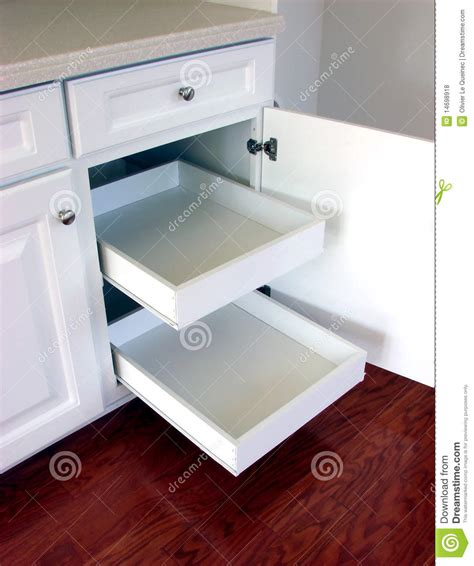 kitchen cabinet organizer pull out drawers pull out kitchen drawers shelves in a modern house stock 7886