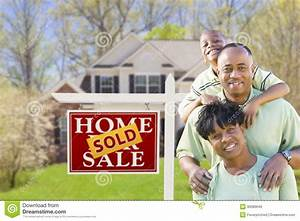 African American Family In Front Of Sold Sign And House ...