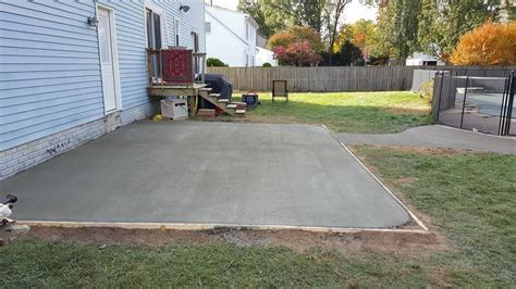 pouring a concrete patio next to house home design ideas