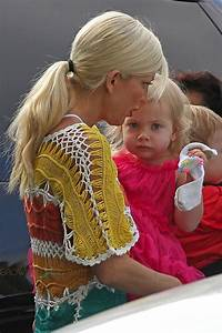 Tori Spelling carries her daughter Hattie while out ...