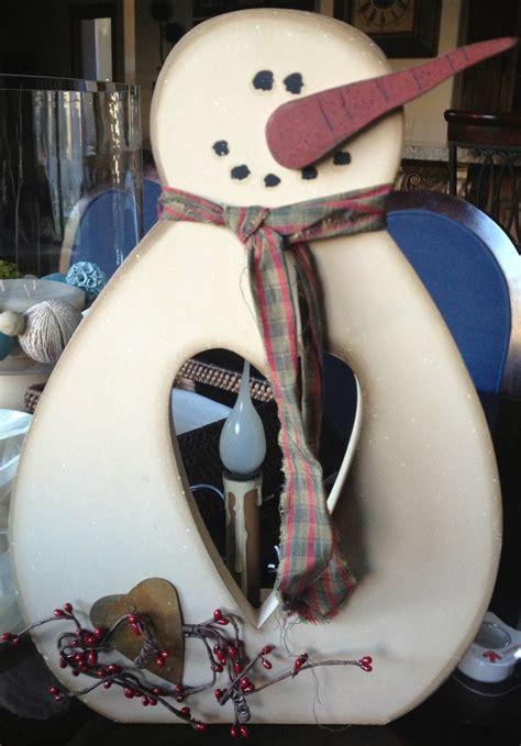 dad built  wooden snowman