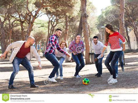 friends playing football stock photo image