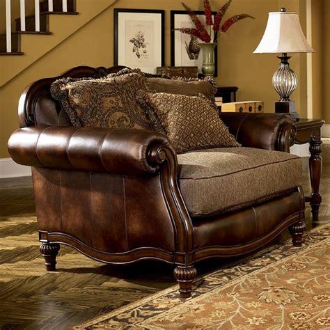 claremore antique sofa loveseat set claremore antique chair and half by signature design by