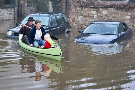 uk weather forecast latest dozens  flood warnings