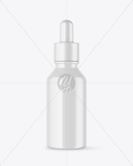 A free sample mockup (full version) showing a floating dropper bottle. Download 50ml Frosted Glass Dropper Bottle Yellowimages ...