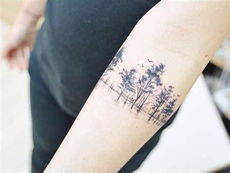 scar cover tree tattoo     forearm tattoo