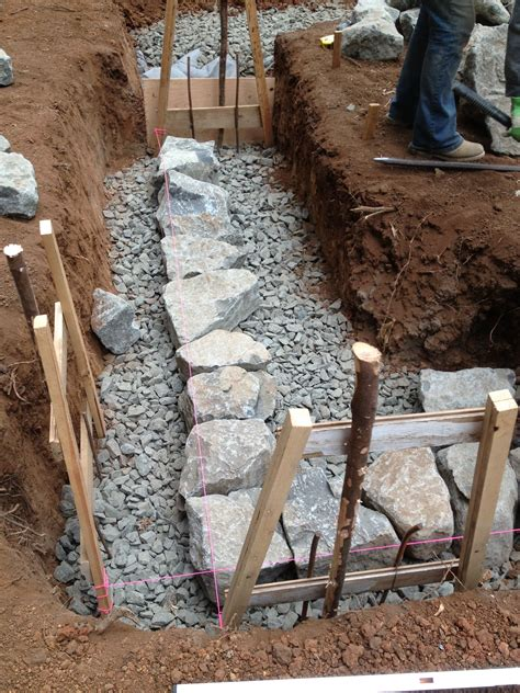 how to build a base for a granite top building a stone foundation this cob house