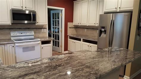 rocky mountain granite with 3 x6 cestino tile backsplash