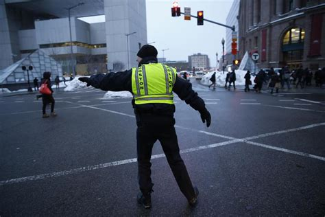 boston police officers direct traffic