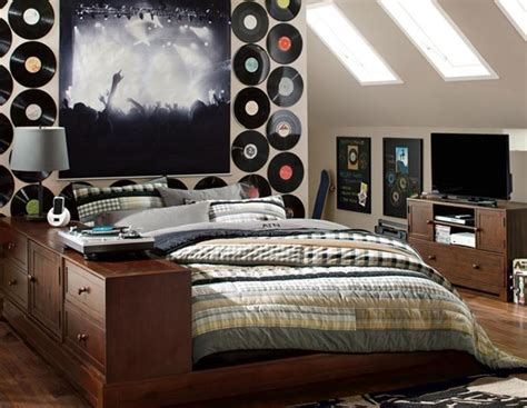 An electric keyboard leans against a bob marley poster, and an electrical guitar and a yellow lounger are within arm's distance of each other. Music Inspired Bedrooms for Teenagers - Rilane