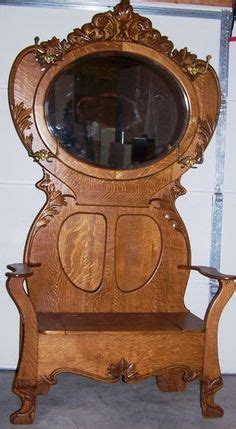 antique oak entry hall tree  storage bench beveled mirror butterfly hook entry hall