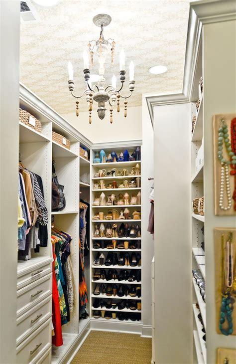 closet  wallpapered ceiling transitional closet